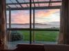 Uitzicht vanuit slaapkamer: zonsopkomst boven Grote Oceaan
